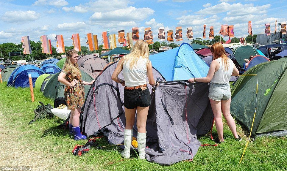 Festival Goers Pitching A Tent