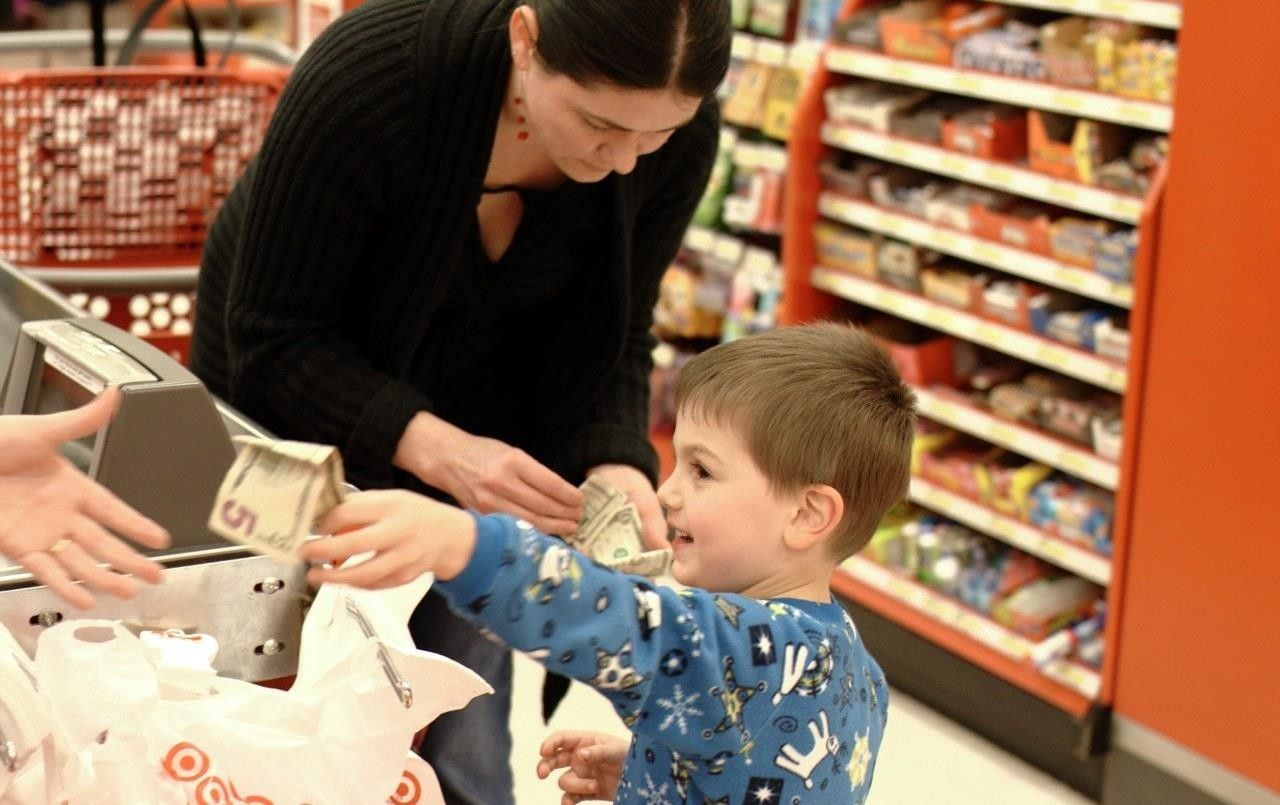 Mum and son buying toys